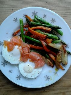 Low calorie evening meal. 2 poached eggs (from our own hens) with smoked salmon, with roasted carrots & asparagus.