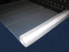 A roll of white aluminum window screen with some unfolded part. Aluminum Screen, Security Screen, Aluminium Windows, Window Screens, Mesh Screen, How To Attract Customers, Wooden Case, Aperture, Aluminium Alloy