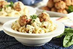 Easy to make ahead for a quick weeknight dinner, Ricotta Turkey Meatballs with Sun-Dried Tomatoes and Garlic Asiago Sauce are light and simply amazing!