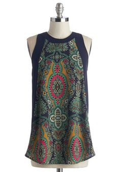 What to wear out this morning? That's a no-brainer - this navy-blue tank top! Fasten the golden buttons of this loose shirt's keyhole behind your neck so you can focus on the real question - whether to order sweet or savory. Solid side panels pair with the pink, mustard, and teal paisley print of this semi-sheer shirt to secure your brunch look as beauteous!