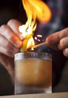 Campfire Sling - 2 oz rye whiskey - 1/4 oz maple syrup - 3 dashes chocolate bitters - Garnish: flamed orange twist