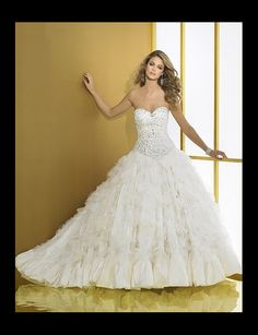 Sara Bridal Fashions, Designer Wedding Gowns and Dresses in Brampton and Mississauga - Our Gowns
