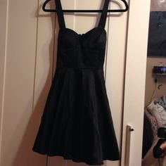 Black satin dress Black satin dress with bra like design on top with straps . Worn once. Has a bow sash on back and has a lining on bottom to give some body on bottom. Looks great on. janette Dresses Mini