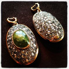 Amazing earrings in gold and silver with emerald root and old cut sapphires by NOL Jewellers