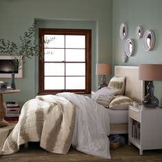 love the mirrors over the bed   wall color?