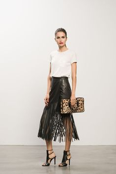 A white tee is the perfect blank canvas for a deconstructed leather fringe skirt and sleek, edgy Tamara Mellon heels. A pop of neutral toned leopard print completes the downtown gallerista look! Passion For Fashion, Love Fashion, Autumn Fashion, Fashion Looks, Womens Fashion, Fashion Trends, Fashion 2014, Style Fashion, Skirt Fashion