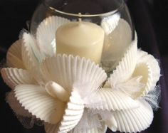 Scallop shell centerpiece for your beach wedding table. White scallops and shells with a center bubble glass container measuring 7 X Seashell Candles, Seashell Art, Seashell Crafts, Sea Crafts, Rock Crafts, Shell Centerpieces, Beach Wedding Tables, Crochet Christmas Decorations, Sea Shells
