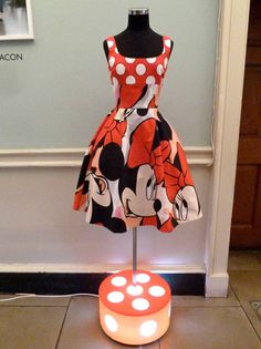 Gorgeous Giles Deacon Minnie Mouse dress at London Fashion Week exhibition.  Noticed a few Disney characters in Harrods kidswear labels last week.