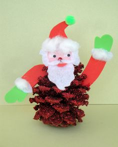 Santa Christmas craft. Pinecone decorated with glitter and craft foam scraps. Copyright Pamela Maxwell 2013