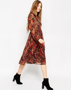 090b8c7151e4a ASOS Long Sleeve Midi Dress In Folk Print With Embellishment at asos.com