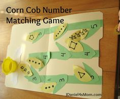 Matching shapes, dots and pictures to the numbers that they represent in a fun folder game.