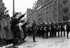November 9, 1940. 5,000 men of the NSB WA march at the corner of Damrak and Dam Square. Dutch nazi (NSB) sympathizers bring the Hitler-salute. ANP Photo/G. v.d. Werff #amsterdam #worldwar2
