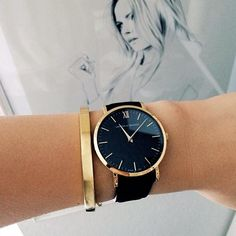 black + gold big faced watch.