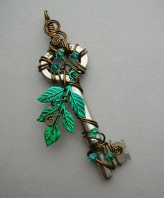 Items similar to Water Tree Wire Wrapped Key Pendant — Blue-green leaves, vintage bronze wire, green and blue Swarovski crystals on Etsy – Gardening for beginners and gardening ideas tips kids Key Jewelry, Leather Jewelry, Cute Jewelry, Bridal Jewelry, Jewelry Making, Unique Jewelry, Dainty Jewelry, Resin Jewelry, Gold Jewelry