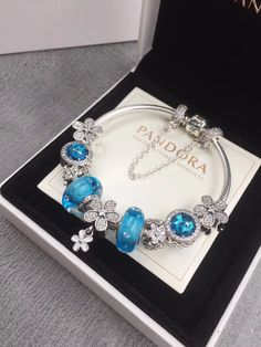 New in our store:pandora blue flow... check it out here!http://www.charmsilvers.com/products/pandora-blue-flower-charm-bracelet-with-9-pcs-blue-flower-charms-birthstone?utm_campaign=social_autopilot&utm_source=pin&utm_medium=pin