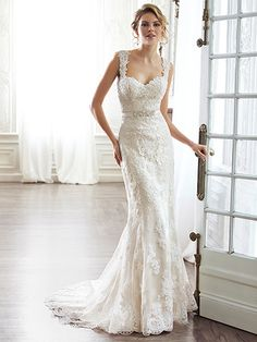 Maggie Sottero - PIA, DISCONTINUED - The pinnacle of romance is found in this streamlined sheath. Rendered in lace and completed with a dramatic V-back. Beautifully detailed with illusion lace. Finished with sweetheart neckline and delicate cap-sleeves. Finished with covered button over zipper and inner elastic closure.