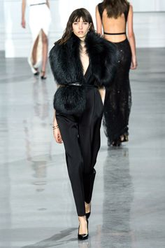 And there was a slink factor, too, in glamorous evening jumpsuits with low cowls or white-hot halter dresses and a '70s-perfect white bow-blouse and cropped pants worn with a sweeping black coat. It felt like a new chapter for Wu. An interesting one.   - HarpersBAZAAR.com