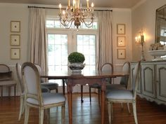 (Nubury Lane blog) love the wall colo, silk drapes, chandelier, 6 framed art prints, large mirror, french buffet, frenchy chairs
