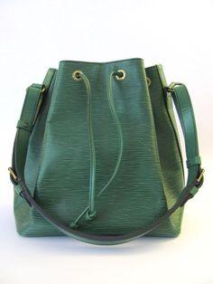 Auth. Louis Vuitton 90's petit noe in epi leather on sale on eBay.