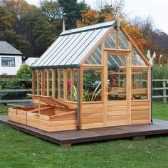 Wooden greenhouses are the perfect backyard greenhouse for the home gardener. Ideas and plans for wooden greenhouses. Diy Greenhouse Plans, Cheap Greenhouse, Greenhouse Effect, Backyard Greenhouse, Greenhouse Wedding, Homemade Greenhouse, Portable Greenhouse, Greenhouse Growing, Greenhouse Farming