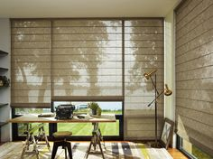 The sophisticated textures of Alustra® Woven Textures® Roman Shades offer endless design possibilities for any room including a home office. ♦ Hunter Douglas window treatments