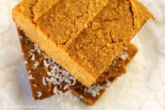 """Pumpkin Pie Squares: These pumpkin squares are easier to make than pumpkin pie and they are firm enough to be eaten as finger food. They are great by themselves, or add a bit of Macadamia-Vanilla Frosting for a little """"Happy Holidays."""""""