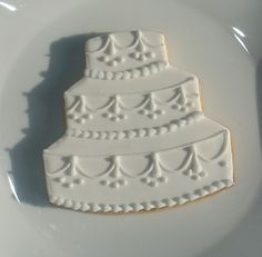 "Wedding Cake Cookie Favor...cute idea...luckily I know ""someone"" who can make these for her if she wants them!"