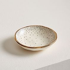 Each piece in Louisa Podlich's collection starts as a tiny ball of clay and is shaped and decorated by hand, a mano. The A MANO Dotted Ceramic Trinket Dish comes in white with a black polka dot print + gold trim and is the perfect spot fo West Elm, Decorative Accessories, Decorative Items, Decorative Bowls, Pottery Painting, Ceramic Painting, Painted Ceramics, Diy Clay, Clay Crafts