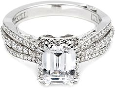 Tacori Triple Row Diamond Engagement Ring  : Slender triplet bands of diamonds create the stunning shoulders on this elegant engagement ring, with a halo of diamonds adding depth and dimension to the emerald cut center stone.