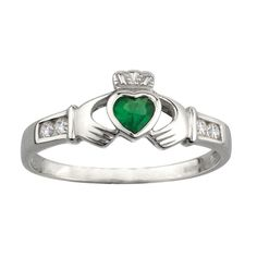 Lovely claddagh ring with CZ on each side and a synthetic emerald in the center all set in sterline silver. Comes in whole and half sizes. Allow up to 3 weeks. Made in Ireland. Comes gift boxed.