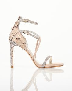 2f20c90e9e2 Stylish sandals by Stuart Weitzman. Flower Shaped details in leather and  studs at the heel