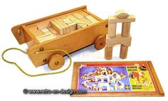 SISO wooden toy cart with blocks Movable wooden toy cart by SISO filled with two layers of wooden building blocks. In nature quality, more than 83 blocks.   SISO was founded in 1946 by Herbert Sieber and his son Fritz Sieber as dolls and wooden toys company in the GDR.  http://www.retro-en-design.co.uk/a-46499017/games/siso-wooden-toy-cart-with-blocks/
