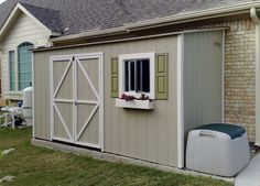 The perfect shed for an unused side of my house! Clever thinking and cute with the window box!!