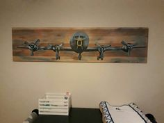 Plane painting on wood. My father did this for our baby boy arriving soon.