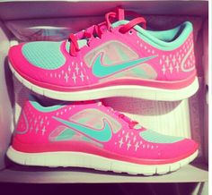 Pink and turquoise nike running shoes