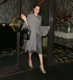 Michael Kors Collection - f you're one to get cold easily (say in the office), take a page out of Angelina's book and get yourself a wrap. Angelina has quite a few stocked up, including this gray wrap from Michael Kors Collection. She matched it to her dress and chose a pump in a similar taupe tone for a night out in 2016. The shawls are perfect whether you're headed to dinner or the airport.