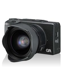 Ricoh GRII. High performanc street shooter. Doesn't look like an expensive camera.