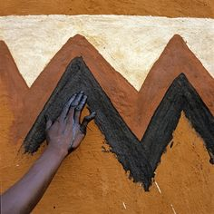 Africa | African Canvas, a series of images that portray a unique tradition of Africa, a celebration of an indigenous rural culture in which the women are the artists and the home her canvas. | © Caption and image Margaret Courtney-Clarke