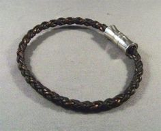 For petite arms. This is a nice natural, braided dark brown leather bracelet. Go casual, It would go great with a pair of jeans.