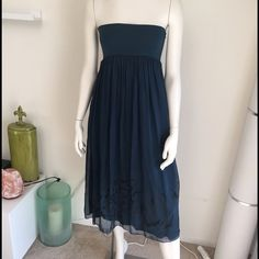 Keysha dress or maxi skirt. Double layer. High waist band. Either wear it as a long bohemian flawy skirt. Teal blue color with black print on the bottom of the skirt. If you are A cup / B cup you can definitely wear as a strapless dress. Made in Italy. Keysha Skirts Maxi