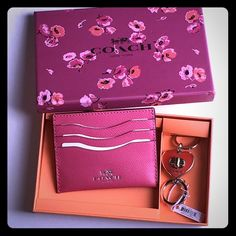 LOWEST PRICE✨COACH✨ keychain/cardholder % AUTHENTIC COACH boxed gift set.  Pink card holder and orange heart keychain beautifully packaged in Coach wildflower gift box.  Brand new with tags!  Would make the perfect gift!  Price is firm. Coach Accessories Key & Card Holders