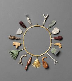 Necklace | Bruce Metcalf  'Rhyme and Pun'. Brass, copper, wood, shell, coral, gourd, acrylic, glass, lint balls, plastic, stainless steel, paint