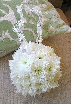 "Chrysantheumum pomander (also called a ""kissing ball"") with winter snowflake trim on the handle."