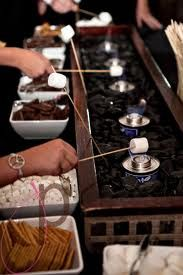 Smores bar at wedding -Roasting the marshmallows. You could add any color rocks or do plain with just a few that match the wedding colors. You could also put the sterno pots in small clay or terra-cotta pots.