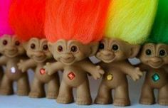Ugly lil trolls!!  If you go to any bingo hall you will see them!!  Supposedly they are ugly good luck charms.