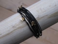 Leather bracelet with Golden butterflies