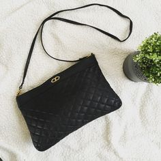 """Vintage Quilted Cross Body Bag Vintage Quilted Cross Body Bag  Black Faux leather Gold hardware Zip closure Removable shoulder strap Large compartment on back with snap closure Interior zipper pocket Zipper pocket on back Measures 11x1x7 Strap 23"""" Bags Crossbody Bags"""