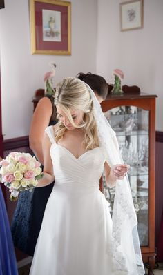 Justin Alexander gown 8710. Sweetheart neckline with ruching. Capped sleeves. Veil with lace trim. G-ma's pearls! Half up half down hair
