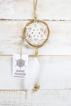 """This small 3"""" crocheted dream catcher wall decor will make a great decorative touch to any interior or your car."""