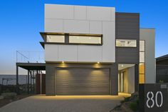 Design & Construct by Pivot Homes. Amazing use of Scyon Cladding on this Highton property. House Cladding, Exterior Cladding, Facade House, House Facades, Wall Cladding, Grey Exterior, Exterior Colors, Custom Home Builders, Custom Homes